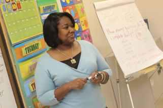 photo of woman teaching